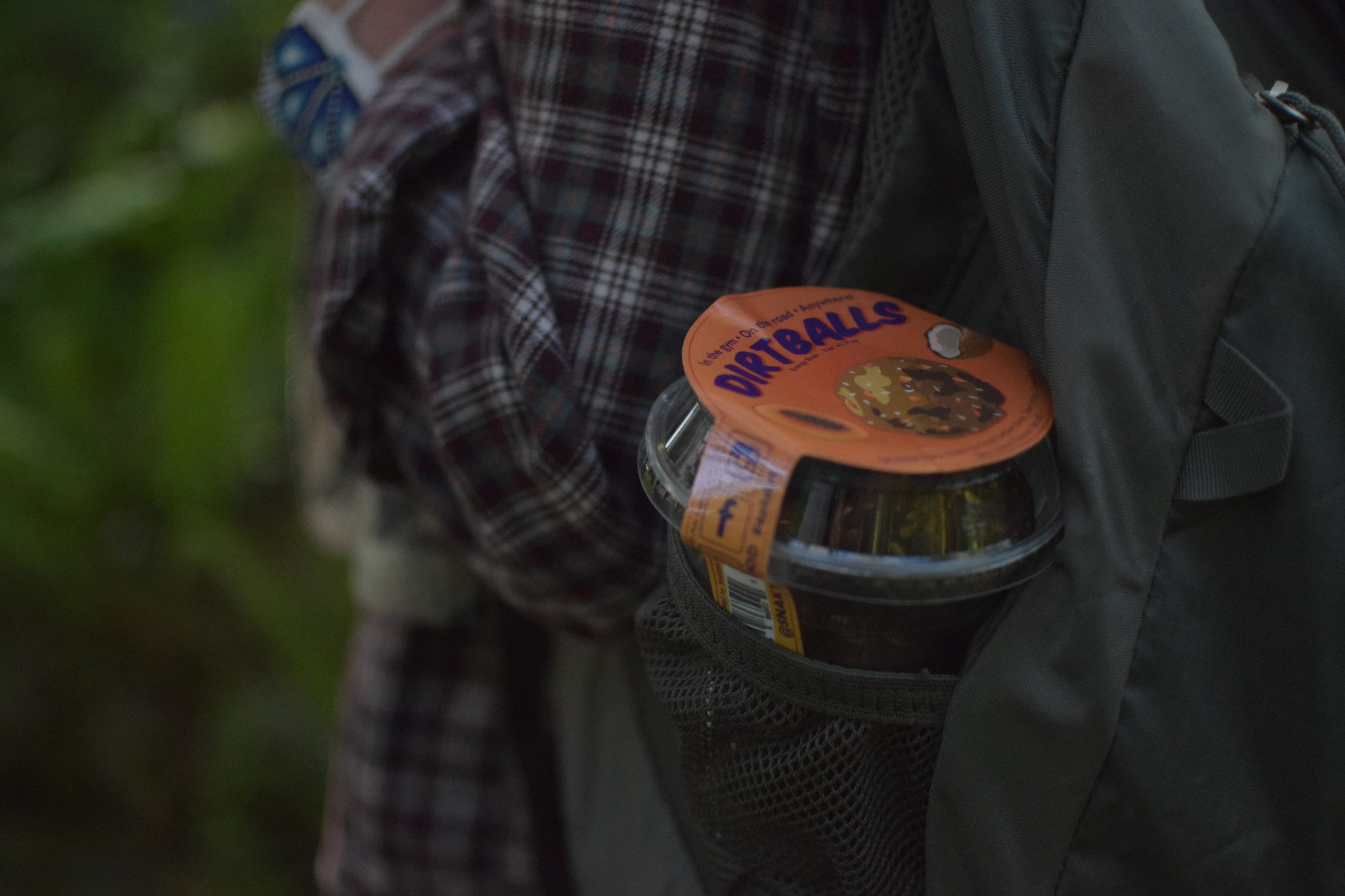 Dirtballs energy bites in a backpack pocket