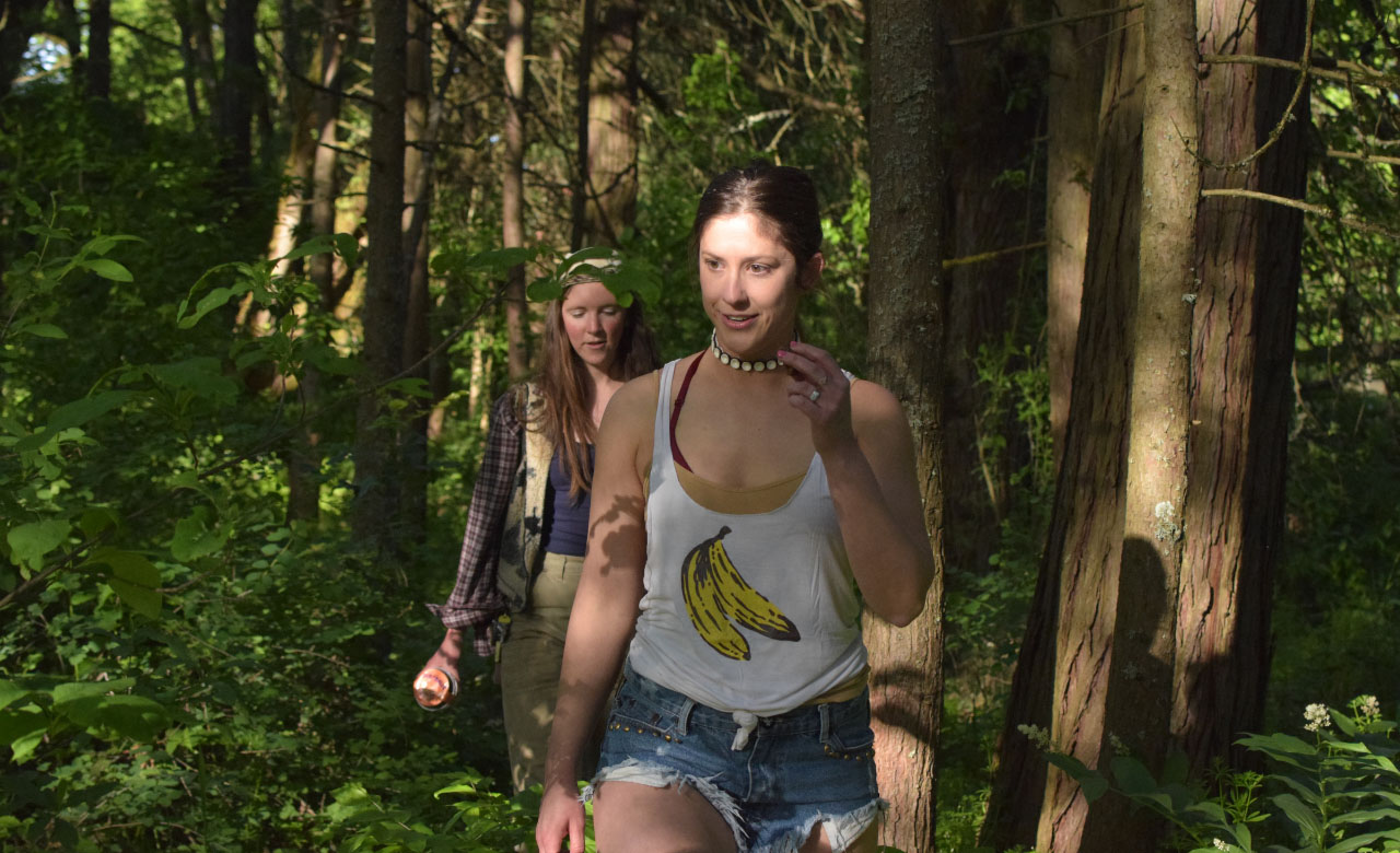 Beautiful ladies walking in the woods