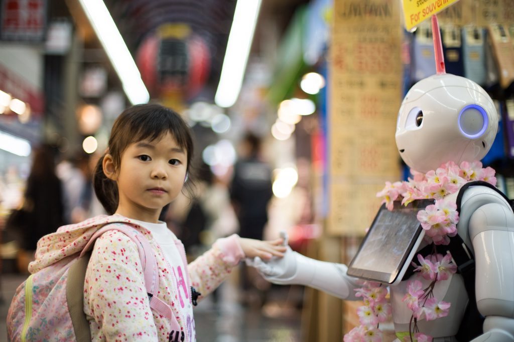 Girl hold hands with robot city street automation