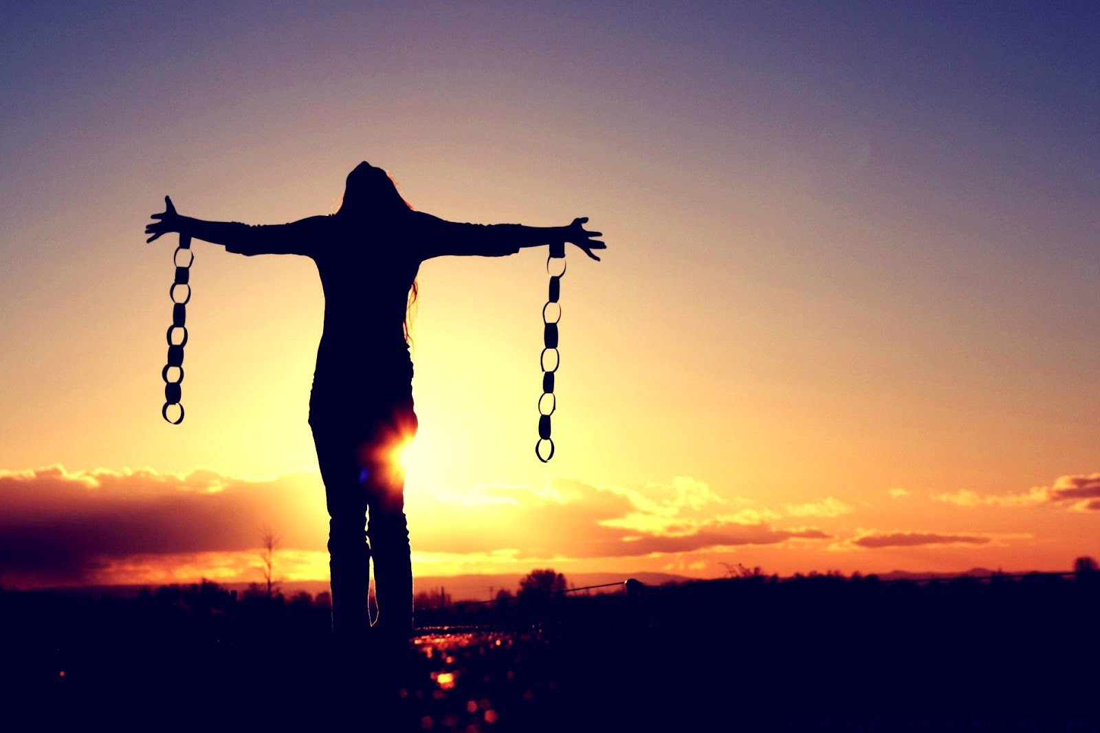 woman chained sunset shackles freedom